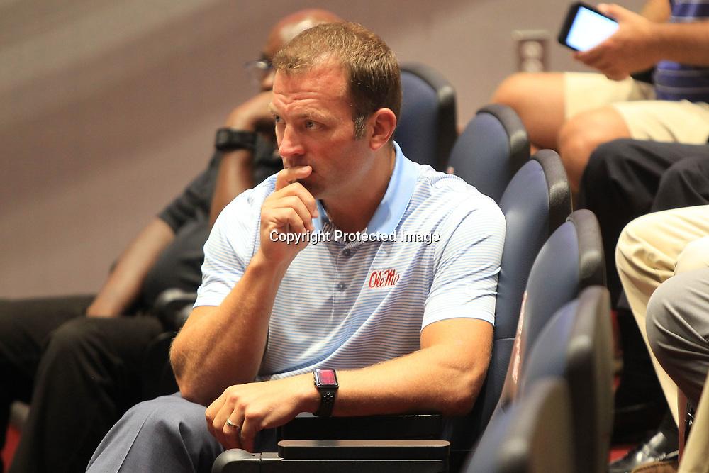Ole Miss Athletic Director Ross Bjork listens during a press conference where Matt Luke, Interim Head Football Coach spoke to the media.