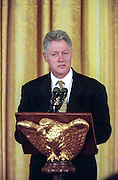 US President Bill Clinton speaks at the annual prayer breakfast in the White House's East Room September 11, 1998 in Washington, DC. Reading from notes as his hushed audience of more than 100 ministers, priests and other religious leaders listened, the president said he had a broken spirit but still hoped to redeem the nation's trust.