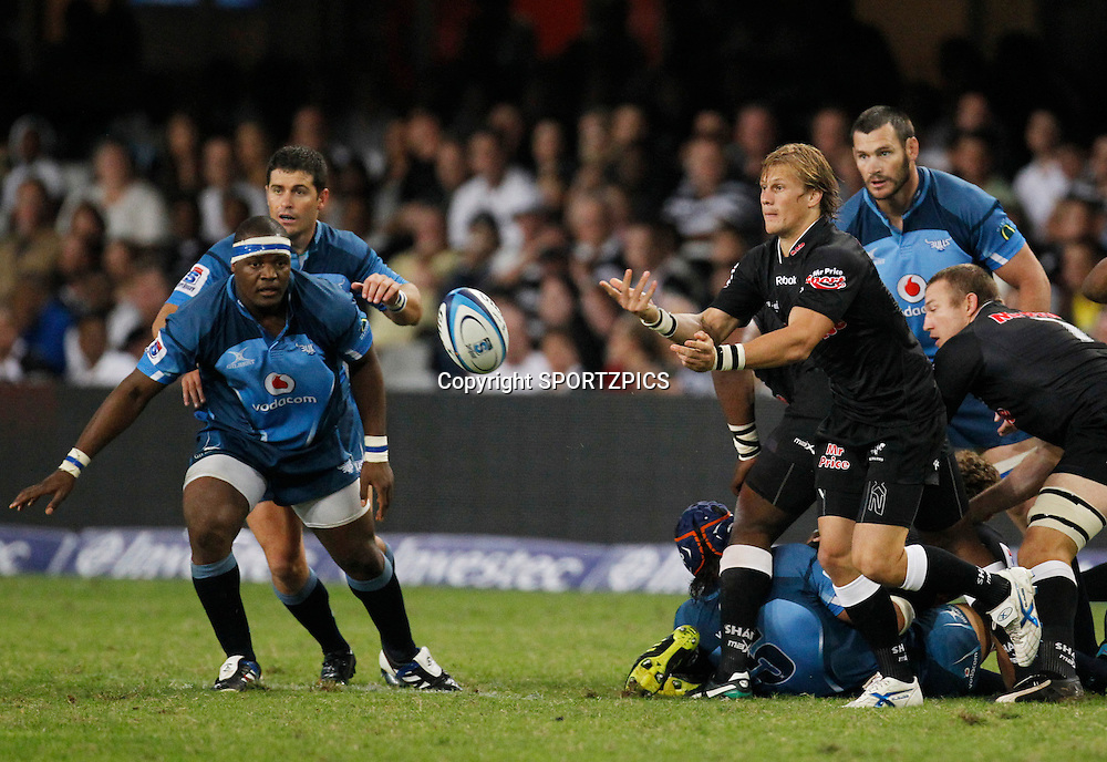 Charl McLeod passes the ball during the Super 15 match between the Sharks and the Bulls played in Durban on the 21 May 2011..Photo by: SPORTZPICS