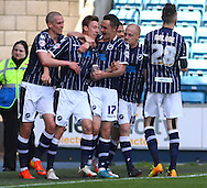 Martyn Woolford of Millwall (2nd left) celebrates scoring the opening goal during the Sky Bet Championship match at The Den, London<br /> Picture by David Horn/Focus Images Ltd +44 7545 970036<br /> 03/05/2014