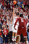 FAYETTEVILLE, AR - DECEMBER 30:   Rotnei Clarke #15 of the Arkansas Razorbacks shoots a three pointer with help from the crowd during a game against the Oklahoma Sooners at Bud Walton Arena on December 30, 2008 in Fayetteville, Arkansas.  The Razorbacks defeated the Sooners 96-88.  (Photo by Wesley Hitt/Getty Images) *** Local Caption *** Rotnei ClarkeUniversity of Arkansas Razorback Men's and Women's athletes action photos during the 2008-2009 season in Fayetteville, Arkansas....©Wesley Hitt.All Rights Reserved.501-258-0920.
