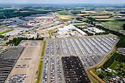 Nederland, Limburg, Gemeente Sittard-Geleen, 26-06-2014; Born, bedrijventerrein Holtum met parkeerterrein Koopman Automotive Solutions, onder andere voor lease auto's. Achtergrond Terminal Born, overslaghaven.<br /> Parking Koopman Automotive Solutions, including company cars.<br /> luchtfoto (toeslag op standaard tarieven);<br /> aerial photo (additional fee required);<br /> copyright foto/photo Siebe Swart.