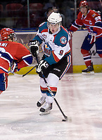 KELOWNA, CANADA, DECEMBER 27: Zach Franko #9 of the Kelowna Rockets skates with the puck as the Spokane Chiefs visit the Kelowna Rockets on December 7, 2011 at Prospera Place in Kelowna, British Columbia, Canada (Photo by Marissa Baecker/Getty Images) *** Local Caption ***