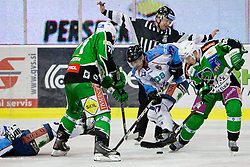 Ken Ograjensek (HDD Tilia Olimpija, #18) and Chad Klassen (SAPA Fehervar AV19, #27) during ice-hockey match between HDD Tilia Olimpija and SAPA Fehervar AV19 at second match in Quarterfinal  of EBEL league, on Februar 21, 2012 at Hala Tivoli, Ljubljana, Slovenia. HDD Tilia Olimpija won 2:1 in OT. (Photo By Matic Klansek Velej / Sportida)
