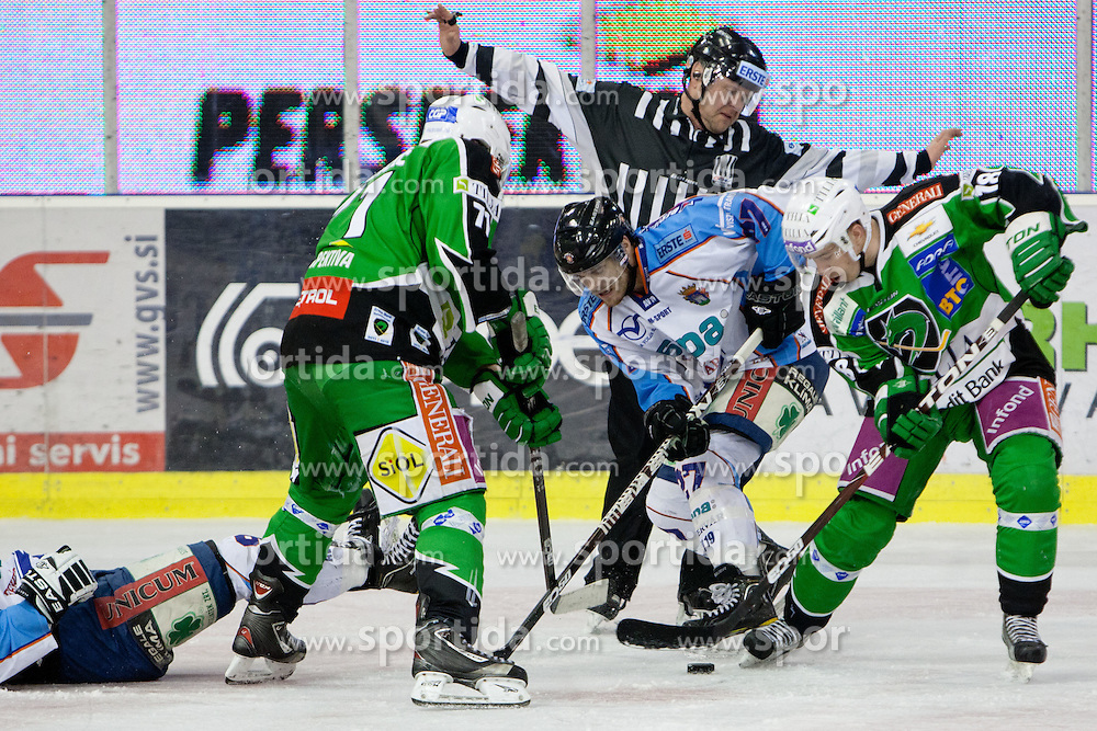 Ken Ograjensek (HDD Tilia Olimpija, #18) and Chad Klassen (SAPA Fehervar AV19, #27) during ice-hockey match between HDD Tilia Olimpija and SAPA Fehervar AV19 at second match in Quarterfinal  of EBEL league, on Februar 21, 2012 at Hala Tivoli, Ljubljana, Slovenia. HDD Tilia Olimpija won 2:1 in OT. (Photo By Matic Klansek Velej / Sportida)