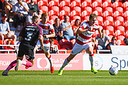 Doncaster Rovers midfielder Kieran Sadlier (7) in action during the EFL Sky Bet League 1 match between Doncaster Rovers and Peterborough United at the Keepmoat Stadium, Doncaster, England on 21 September 2019.