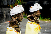 Clothed temple statues in Tembok Temple, Bali, Indonesia.