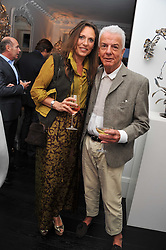 SARA CARELLO and NICKY HASLAM at the after party for the press night of 'As I Like It' held at the home of Amanda Eliasch, 24 Cheyne Walk, London on 5th July 2011.