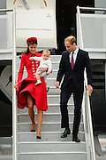 Britain's Prince William and his wife Catherine wave upon their arrival at the international airport in Wellington on April 7, 2014.  William, Kate and their son Prince George are on a three-week tour of New Zealand and Australia.    AFP PHOTO / MARK TANTRUM