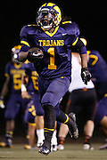 Milpitas High School running back Savion Black (1) carries the ball down the field against Woodside at Milpitas High School in Milpitas, California, on September 13, 2013. The Trojans went on to beat the Wildcats 50-6. (Stan Olszewski/SOSKIphoto)