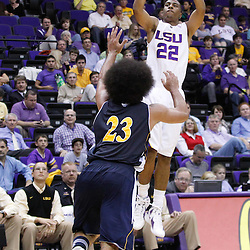 December 15, 2011; Baton Rouge, LA; LSU Tigers guard Ralston Turner (22) shoots over UC Irvine Anteaters guard Michael Wilder (23) during the second half of a game at the Pete Maravich Assembly Center. LSU defeated UC Irvine 66-59.  Mandatory Credit: Derick E. Hingle-US PRESSWIRE