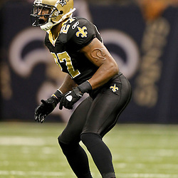 November 28, 2011; New Orleans, LA, USA; New Orleans Saints safety Malcolm Jenkins (27) against the New York Giants during the second half of a game at the Mercedes-Benz Superdome. The Saints defeated the Giants 49-24. Mandatory Credit: Derick E. Hingle-US PRESSWIRE
