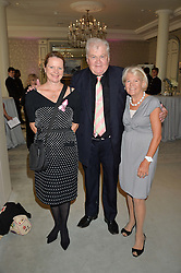 Left to right, HANNAH DAWS and ANTHONY & MARJORIE SIMONDS-GOODING at the Future Dreams 'United For Her' Ladies Lunch 2016 held at The Savoy, London on 10th October 2016.
