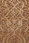 """Detail of carved wooden column in central patio of entrance to Tellya Sheikh Mosque, founded 16th century, restored 19th century, Khast Imam Square, Tashkent, Uzbekistan, seen in the late afternoon summer light on July 4, 2010. Tashkent's main Friday mosque holds the Osman Koran, claimed to be the world's oldest, in its library. Tashkent, 2000 year old capital city of Uzbekistan, a Silk Road city whose name means """"Stone Fortress"""", is now very modern due to a disastrous earthquake in 1966, after which it was greatly rebuilt. However, some of the old buildings still stand in the glittering modern city. Picture by Manuel Cohen."""