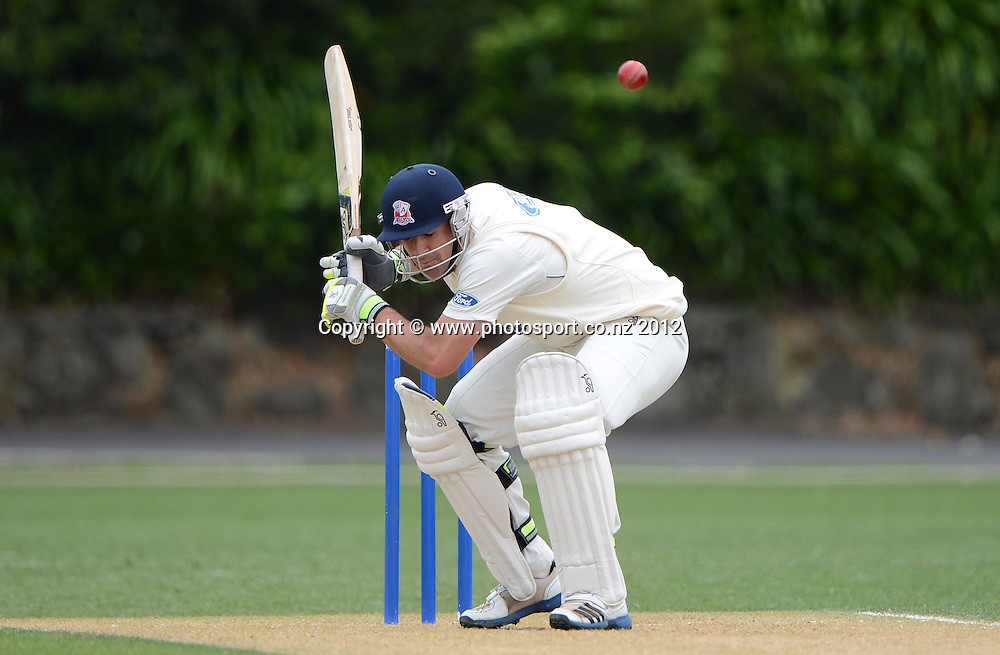 Colin de Grandhomme ducks a bouncer. Plunket Shield Cricket, Auckland Aces v Northern Knights at Eden Park outer oval. Sunday 11 November 2012. Photo: Andrew Cornaga/Photosport.co.nz