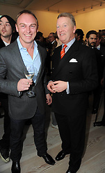 Left to right, TONY LEWIS and FRANK WARREN at a reception to launch the Saatchi Opus held at the Saatchi Gallery, King's Road, London on 26th November 2009.