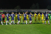 AFC Wimbledon and Southend United players shake hands before the EFL Trophy match between Southend United and AFC Wimbledon at Roots Hall, Southend, England on 13 November 2019.