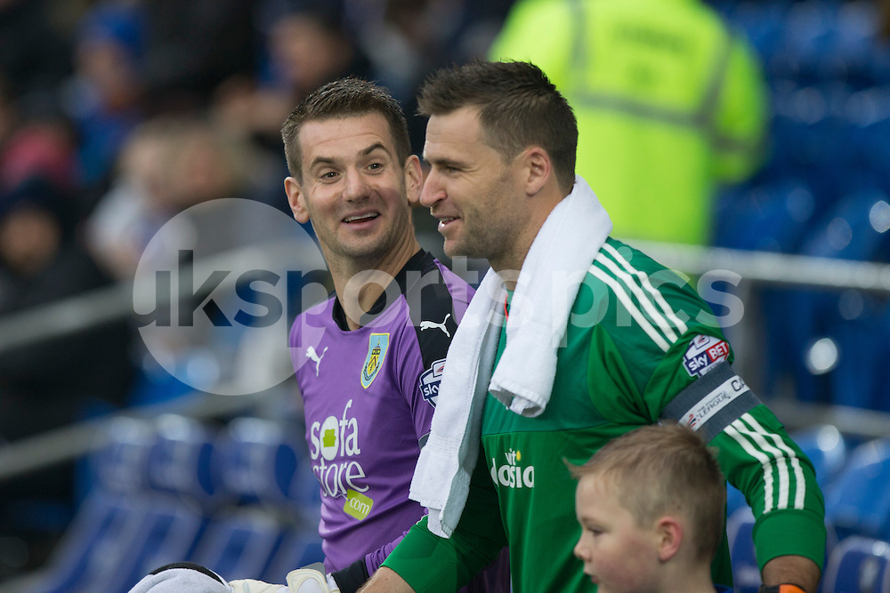 Goalkeepers and captains Tom Heaton of Burnley and David Marshall of Cardiff City share a joke as they lead their sides out for the Sky Bet Championship match between Cardiff City and Burnley at the Cardiff City Stadium, Cardiff, Wales on 28 November 2015. Photo by Mark Hawkins.