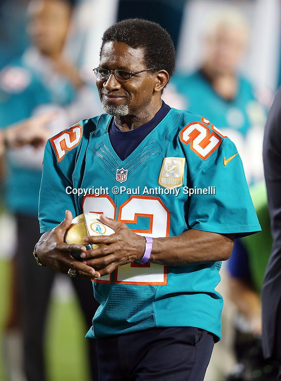 Former Miami Dolphins running back Mercury Morris smiles during a halftime ceremony honoring the 50 all-time Dolphin great players during the Miami Dolphins NFL week 14 regular season football game against the New York Giants on Monday, Dec. 14, 2015 in Miami Gardens, Fla. The Giants won the game 31-24. (©Paul Anthony Spinelli)
