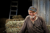 Old time Vermont farmer takes a break from his chores.  Waitsfield, Vermont