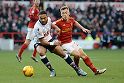 Bolton Wanderers midfielder Liam Feeney turns Nottingham Forest midfielder Ben Osborn during the Sky Bet Championship match between Nottingham Forest and Bolton Wanderers at the City Ground, Nottingham, England on 16 January 2016. Photo by Alan Franklin.
