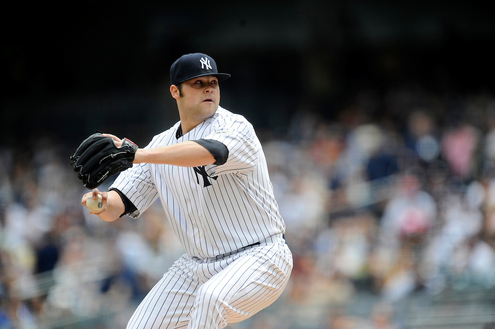 NEW YORK - MAY 16: Joba Chamberlain #62 of the New York Yankees pitches against the Minnesota Twins on  May 16, 2009 at Yankee Stadium in the Bronx borough of New York City.The Yankees defeated the Twins 6 to 4 in 11 innings. (Photo by Rob Tringali) *** Local Caption ***  Joba Chamberlain