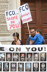 © Licensed to London News Pictures. 09/10/2013. London, UK. Protesters are seen outside the Foreign and Commonwealth Office in Westminster, London, today (09/10/2013) as they demonstrate for more help from the government when loved ones die abroad. Photo credit: Matt Cetti-Roberts/LNP