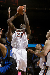 Virginia Cavaliers center Tunji Soroye (21) shoots over Longwood Lancers guard Maruice Sumter (45).  The Virginia Cavaliers Men's Basketball Team defeated Longwood University 90-49 at the John Paul Jones Arena in Charlottesville, VA on February 13, 2007.