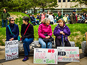 29 APRIL 2017 - MINNEAPOLIS, MINNESOTA: Women sit in front of the federal courthouse in Minneapolis before the People's Climate Solidarity March. Thousands of people marched through downtown Minneapolis and rallied around the US Federal Courthouse to participate in the People's Climate Solidarity March. The Minneapolis march coincided with other marches to protest the climate change policies of President Trump and the Republican Party that were held across the US. It took place just one week after a series of large marches in support science and fact based decision making.     PHOTO BY JACK KURTZ