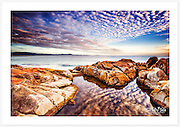 Morning clouds reflected in a still rockpool at Monument Point [South West Rocks, NSW]<br />