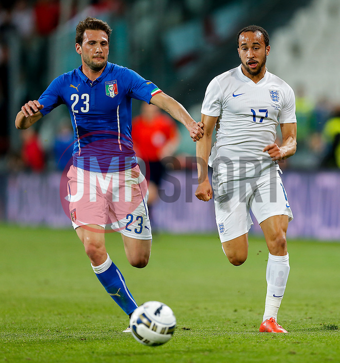 Andros Townsend of England is challenged by Franco Vazquez of Italy - Photo mandatory by-line: Rogan Thomson/JMP - 07966 386802 - 31/03/2015 - SPORT - FOOTBALL - Turin, Italy - Juventus Stadium - Italy v England - FIFA International Friendly Match.