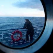 "Trough the porthole, on the ferry ""Toscana"" going to Naples. Mediterranean Sea. A bord du Ferry ""Toscana"" vers Naples. Mer Méditerranée ."
