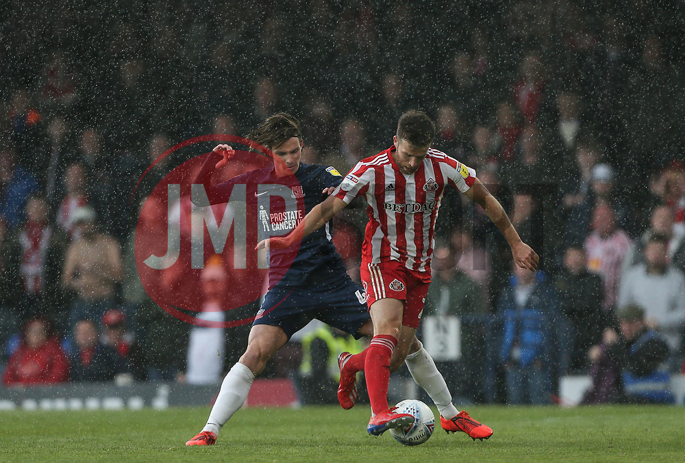 Will Grigg of Sunderland holds the ball up under pressure from Sam Hart of Southend United - Mandatory by-line: Arron Gent/JMP - 04/05/2019 - FOOTBALL - Roots Hall - Southend-on-Sea, England - Southend United v Sunderland - Sky Bet League One