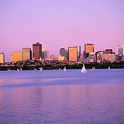 Boston Massachusetts USA skyline and sailboats on Charles River at sunset