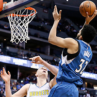 15 February 2017: Minnesota Timberwolves center Karl-Anthony Towns (32) goes for the jump shot over Denver Nuggets forward Nikola Jokic (15) during the Minnesota Timberwolves 112-99 victory over the Denver Nuggets, at the Pepsi Center, Denver, Colorado, USA.