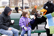 Terry (left) and Haley Krogman, 9 of Covington, Ohio get a visit from  Parker the Penquin during a session with the ice rink's mascot at the RiverScape MetroPark in downtown Dayton, Sunday, January 22, 2012.