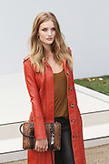 19.SEPTEMBER.2011. LONDON<br /> <br /> ROSIE HUNTINGTON-WHIETLEY ARRIVES AT THE BURBERRY SPRING/SUMMER 2012 COLLECTION SHOW, AT KENSINGTON GORE, FOR LONDON FASHION WEEK IN HYDE PARK, LONDON<br /> <br /> BYLINE: EDBIMAGEARCHIVE.COM<br /> <br /> *THIS IMAGE IS STRICTLY FOR UK NEWSPAPERS AND MAGAZINES ONLY*<br /> *FOR WORLD WIDE SALES AND WEB USE PLEASE CONTACT EDBIMAGEARCHIVE - 0208 954 5968*