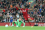 13 Willy Caballero for Chelsea FC misses his challenge allowing 15 Daniel Sturridge for Liverpool FC to pounce during the EFL Cup match between Liverpool and Chelsea at Anfield, Liverpool, England on 26 September 2018.