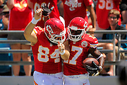 Kansas City Chiefs wide receiver Donnie Avery (17) celebrates with tight end Sean McGrath (84) after scoring against the Jacksonville Jaguars at EverBank Field on Sept. 8, 2013 in Jacksonville, Florida. The Chiefs won 28-2.<br /> <br /> ©2013 Scott A. Miller