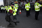 London 04/01/09: Protests outside the Israeli Embassy in London UK:  A protester is held by a police officer after a minor scuffle