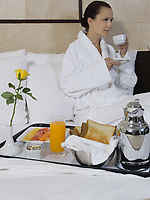 beautiful calm and serene woman in palace hotel room having her breafast