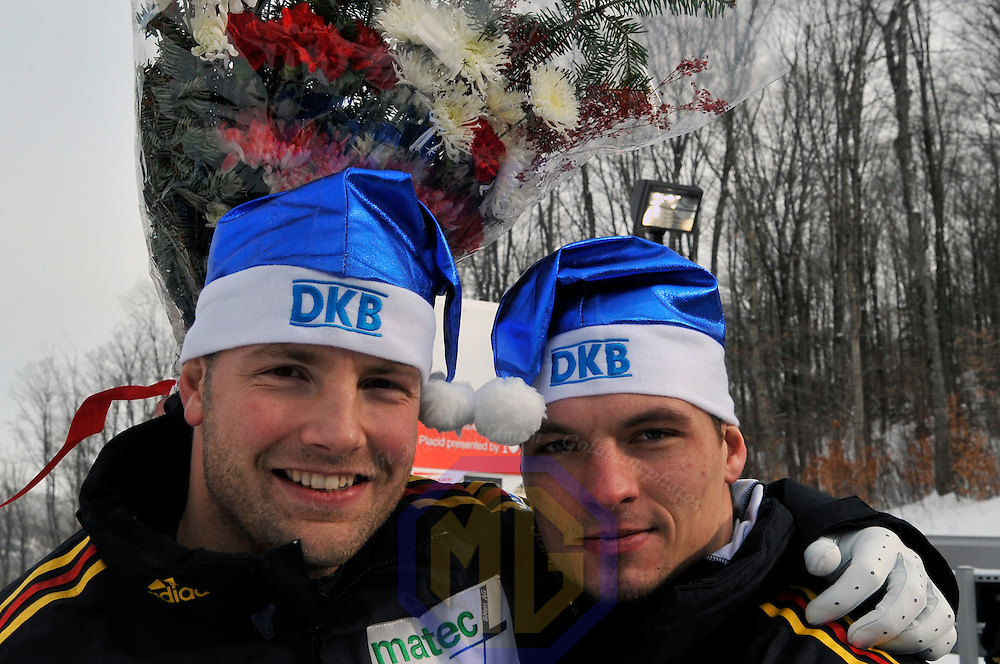 15 December 2007:  The  Germany 1 sled driven by Andre Lange (L) with Martin Putze (R) on the brakes celebrate their 2nd place finish in the FIBT World Cup Men's 2-man bobsled competition on December 15, 2007 at the Olympic Sports Complex in Lake Placid, NY.   The race was won by the Canada 1 sled with a time of 1:50.64.