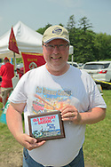 Old Westbury, New York, USA. June 2, 2019. KEITH GRAMLICH, holds the award plaque his 1928 Studebaker Dictator, Club Sedan won at the 53rd Annual Spring Meet Antique Car Show, sponsored by the Greater NY Region (NYGR) of the Antique Automobile Club of America (AACA), at Old Westbury Gardens, a Long Island Gold Coast estate.