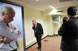 Jean-Claude Juncker, Luxembourg's prime minister, speaks on the phone while reporters wait to interview him during his press conference following the European Union Summit at the EU headquarters in Brussels, Belgium, on Thursday, Nov. 19, 2009. European leaders set divisions aside today as they chose their first-ever European Union president to represent the 27-nation bloc on the world stage. (Photo © Jock Fistick)