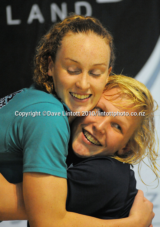Sophia Batchelor hugs Ashburton's Danyelle Lusty after winning gold in the 15 year old girls 100m medley. New Zealand Age Group Short Course Swimming Championships at Welllington Aquatics Centre, Kilbirnie, Wellington on Sunday, 26 September 2010. Photo: Dave Lintott/photosport.co.nz