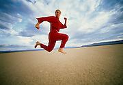 Red jump suit in desert
