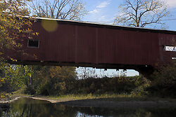14 Oct 2011: Crooks Bridge.  Built to a span of 132 ft to span Little Raccoon Creek on Wimmer Road in 1856. Rural Indiana, Near or in Parke County This image was produced in part utilizing High Dynamic Range (HDR) or panoramic stitching or other computer software manipulation processes. It should not be used editorially without being listed as an illustration or with a disclaimer. It may or may not be an accurate representation of the scene as originally photographed and the finished image is the creation of the photographer.