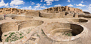 Kivas for Puebloan religious rituals. Chetro Ketl was a massive stone building (Puebloan Great House) occupied from 950-1250s AD, now preserved at Chaco Culture National Historical Park, New Mexico, USA. This park hosts the densest and most exceptional concentration of pueblos in the American Southwest and is a UNESCO World Heritage Site. Chaco Canyon is in remote northwestern New Mexico, between Albuquerque and Farmington, USA. From 850 AD to 1250 AD, Chaco Canyon advanced then declined as a major center of culture for the Ancient Pueblo Peoples. Chacoans quarried sandstone blocks and hauled timber from great distances, assembling fifteen major complexes that remained the largest buildings in North America until the 1800s. Climate change may have led to its abandonment, beginning with a 50-year drought starting in 1130. This panorama was stitched from 7 overlapping photos.