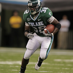 Sep 12, 2009; New Orleans, LA, USA; Tulane Green Wave running back Andre Anderson (32) runs with the ball against the BYU Cougars during the second quarter at the Louisiana Superdome.  Mandatory Credit: Derick E. Hingle-US PRESSWIRE