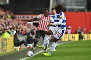 Brentford defender Moses Odubajo (2) and Queens Park Rangers midfielder Eberechi Eze (10) *** during the EFL Sky Bet Championship match between Brentford and Queens Park Rangers at Griffin Park, London, England on 2 March 2019.